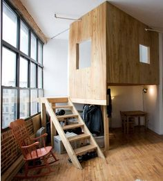 The treehouse bedroom occupies one corner of the loft and includes a study space below.