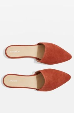 The ease of a flat made even easier, as this backless slide with a gentle almond toe all in luxe suede.