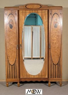 murphy bed idea. we have the large mirror in the basement . . .?