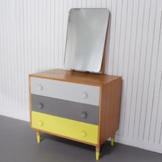 Foster - £270.00 - Boldly painted drawers enhance the retro feel of this mid-century dresser and the dip painted feet add a pop of colour.