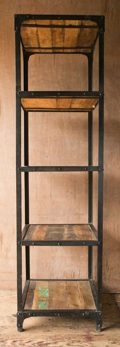 Rustic meets industrial in this stand-alone bookcase featuring reclaimed wood…