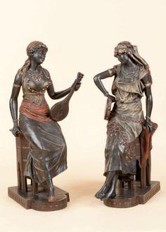 Louis HOTTOT (1834-1905) (D'après)   Musiciennes Paire d'epreuves en régule polychrome, signée sur la terrasse. Haut.: 47cm