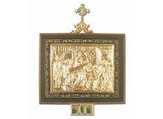 Vía Crucis de bronce con marco de madera