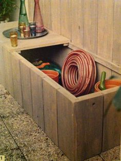 Lidded timber bunker, built up against a fence. (Taken from Terrence Conran's How To Live In Small Spaces.)
