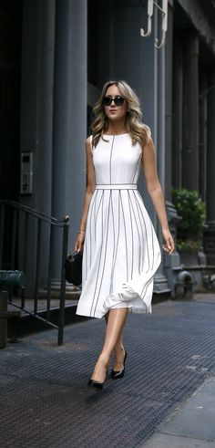 white pleated sleeveless a-line midi dress with black piping illusion pleats // classic summer style // perfect for the office or any special event!