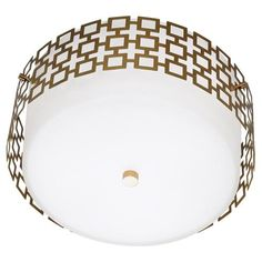Antique Brass Finish over Steel  Frosted White Cased Glass Shade and Perforated Metal Outer Shade from Jonathan Adler (Parker flush)
