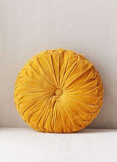 mustard yellow velvet cushion from athropologie | interiors | interior design | comfort for the sofa