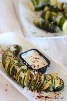 Baked Hasselback Zucchini with garlic. Move over Starchy potatoes! I found a less indulgent side for ma meals!