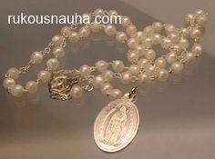 Tämä rukousnauha kantaa nimeä Kyynelten Ruusukko. Helmet ovat pakeliittia. Medaljongissa Neitsyt Maria, Our Lady of Miracles. www.rukousnauha.com