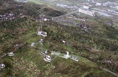 In this aerial photo taken on Saturday, Nov. 9, 2013 and released by Philippine Air Force on Tuesday, Nov. 12, 2013, a statue of Jesus Christ stands on Calvary Hill scattered by trees fallen by Typhoon Haiyan in Tacloban city in Leyte Province, central Philippines. Four days after Typhoon Haiyan devastated islands in the central Philippines, survivors are desperate for food and clamoring to be evacuated. (AP Photo/Philippine Air Force)