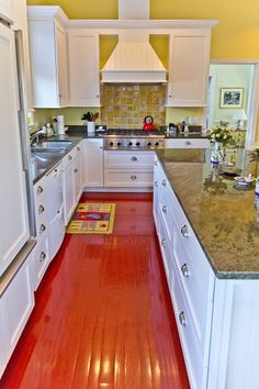 Painted kitchen floor sparkles.
