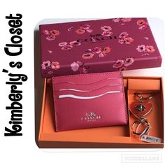 ✨COACH✨ keychain/cardholder % AUTHENTIC COACH boxed gift set.  Pink card holder and orange heart keychain beautifully packaged in Coach wildflower gift box.  Brand new with tags!  Would make the perfect gift! Coach Accessories Key & Card Holders