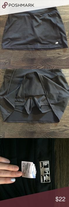 EUC New Balance running skort EUC New Balance running skort. Great condition, shorts stay in place. So comfortable even for the distance runner!!! Great to and from the gym / trail piece. New Balance Skirts