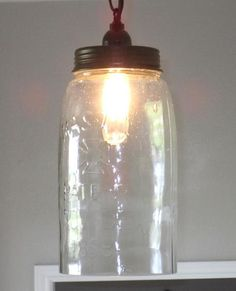 """This mason jar is HUGE!The single jar pendant hangs at 32"""" with the jar at 11 3/4"""" tall and a diameter of 6"""". The bottom of the jar is cut out.It comes with a 4"""