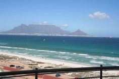 Portico 706 - Portico 706 is an upmarket self-catering apartment with stunning views of Table Mountain and the sea. Enjoy this luxurious two-bedroom, two-bathroom apartment situated on the beachfront in Bloubergstrand. Table Mountain Cape Town, Two Bedroom, Weekend Getaways, South Africa, Catering, Sea, Adventure, Mountains, Bathroom