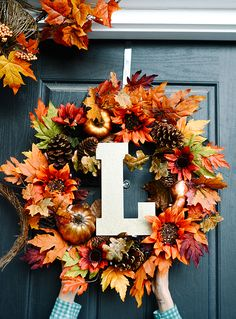 Personalize your fall wreath with a monogram. That's just one of the very simple fall decorating ideas from Ashley Lloyd of Let's Mingle on The Home Depot Blog. Click through to see more of her front porch decorated for autumn. || @letsmingleblog