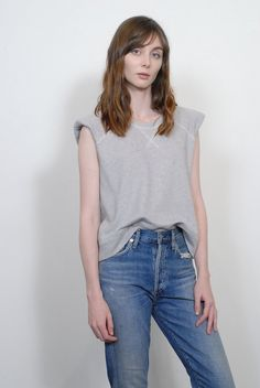 Unstructured and sleeveless, this forward sweatshirt ends at the high hip, meeting the top of your waistband. It features a raw armhole edge and padded shoulders. Paired with Citizens of Humanity Liya Fabric Cotton, Cashmere Model wearing size XS Citizens Of Humanity Liya, Essential Wardrobe Pieces, Tailored Jacket, Shoulder Pads, Heather Grey, Cashmere, Menswear, Sweatshirts, Blouse