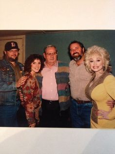 Dolly Parton: I love the way the bloke in the middle is just staring at her huge boobs!