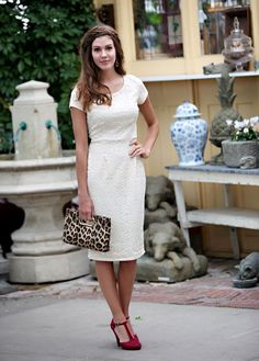 This exquisite lace dress is cream, and features a round neck with cap sleeves. It is fully lined. Pair with any color belt to give your outfit a pop of color! Fabric: Lace - 90% Nylon, 10% Spandex Care: Machine gentle wash cold, Hang Dry