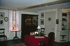 Louisa May Alcott's Study - The great sun shines in it all day, the great fireplace roars, and the warm crimson hangings temper the sunlight and reflect the firelight. Quaint mottoes and pictures hang on the walls.
