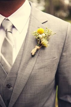 I like the grey suit with yellow flower. Switch with a tight yellow rose with purple accents around it?