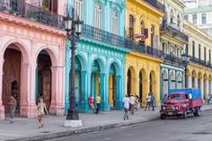 HAVANA-JUNE street scene with people and colorful buildings on June 2013 in Havana.With over 2 million inhabitants Havana is the capital of Cuba and the largest city in the Caribbean - stock photo Varadero, Places To Travel, Places To See, Travel Destinations, Havana Cuba, Going To Cuba, Equador, Colourful Buildings, Cuba Travel