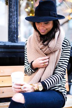 Kat Tanita of With Love From Kat wears a stripe sweater with J Brand ripped jeans, Sam Edelman petty booties, a Nordstrom cashmere scarf and black felt hat.