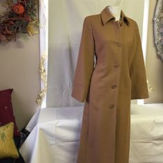 Harvey Benard Camel Wool Coat Tan. Camel wool. Pointed collar. 5 buttons in front. Side slotted pockets. Detail on waist. Coat measures from shoulder to hem line 48 1/2 inches long. Great dressy or casual coat. Well constructed. Excellent condition! Havery Benard Jackets & Coats