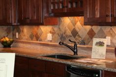 Beautiful backsplash - love the variety in the tiles above, not crazy about the lower section though.