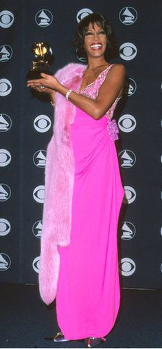 Whitney Houston showed off her Grammy in 2000