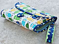 Need to make this! Fold up diaper and wipe pouch-and you can prob use it as the diaper changer too!