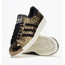 new product bbf1d d650d Adidas Women Shoes - Adidas gold and black plated toe New with tags no box  left shoe very tiny nick on metal toe hardly noticeable. Adidas Shoes  Sneakers ...