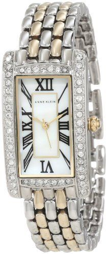 Anne Klein Women's AK/1077MPTT Swarovski Crystal Accented Rectangle Two-Tone Bracelet Watch Anne Klein. $84.86. Water-resistant up to 100 ft. Genuine mother-of-pearl dial with black roman numeral markers at all hours; silver-tone hour, minute and second hands. 50 clear, genuine swarovski crystals set on bezel sides and lugs. 21 mm wide rectangle shaped polished silver-tone case with gold-tone crown. Polished two-tone adjustable link bracelet with jewelry clasp closure and extender