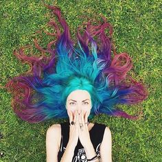 Teal, blue, purple, and burgundy hair. The way it's laying, it looks like fire.