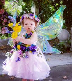 Olivia's 1st fairy photoshoot. Dress and halo made with love by Mommy & Grammy. #FairyPhotos #FairyPhotoshoot #Fairy