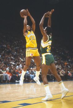 World B Free of the Golden State Warriors shoots over Armond Hill of the Seattle Supersonics during an NBA basketball game circa 1980 at the...