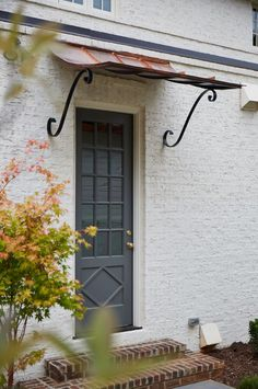 Creamy White Brick Exterior with grey front door Tammy Coulter Design - Grandfather Homes Front Door Awning, Front Door Canopy, Copper Awning, Architecture Design, Best Front Doors, Door Coverings, Front Door Design, Farmhouse Design, Farmhouse Door