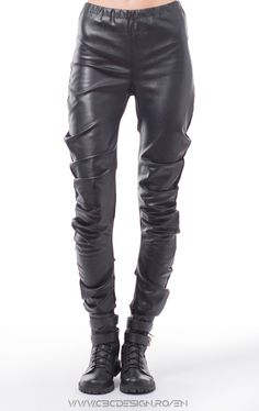 Eco leather faced leggings with stretch suiting fabric on the back. Based on a circular pattern, they wrap around the leg beautifully, creating side pleats. Sport – chic and casual at the same time, they make a very versatile item: worn with Air Max shoes, a simple top and a baseball cap for a hip-hop look. Or with platforms and a shiny top for a glam night. Because of the matte finish, they can be transformed into an office look, paired with stilettos and a crisp white shirt.