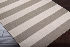 Beige and taupe striped rug.  Love the feel this would give our entryway.
