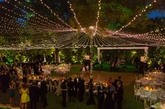 """A creative lighting plan will really elevate a design scheme. """"We used strands of twinkle lights to create a glowing canopy over an outdoor reception, which brought it to a whole other level,"""" says Becky Navarro of Pearl Events Austin.Related: 25 Ways to Transform Your Wedding With Lighting"""