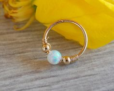 ♥The listing is for small gold filled piercing with tiny opal bead.  ♥Materials…