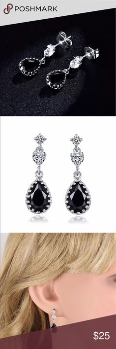 "Black topaz 18k white gold earrings Classy 18k white gold filled earrings have a black topaz center stone  and simulated diamonds . Dangle is approx. 1"" comes boxed . Jewelry Earrings"