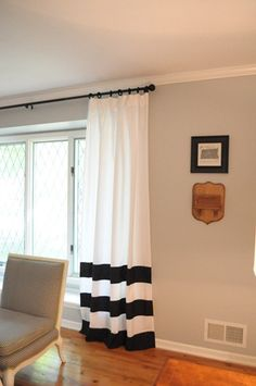 love these diy curtains made out of a sheet and some spare black fabric