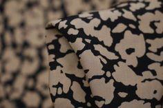 Designer black/camelprinted Japanese technical 100% polyester. 150cm wide. Ideal for ...