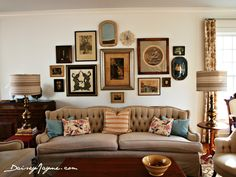 Just about the perfect example of a gallery wall done right!  Love the mix of frame styles and all the artwork in the same general color scheme!!!