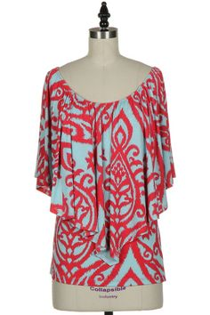 Coral and turquoise....off the shoulder, one shoulder or both. 3 different looks, one great shirt!