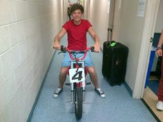 Louis riding his bike backstage