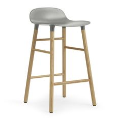 Create a contemporary interior setting with this Oak Form Barstool from Normann Copenhagen. Made from plastic with contrasting lacquered oak legs, it is simplistic in style and complements a wide rang