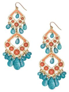 $24 Gypsy chic meets the tropical allure of Ms. Carmen Miranda in these knockout statement earrings. They're crafted from gorgeously raw gemstones, in bright turquoise and orange, for a look that's glamorously bohemian.