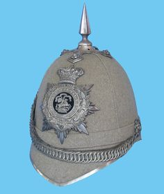 A Grey cloth version of the Home Service Helmet normally associated with Volunteer Battalions but some volunteer units wore the blue cloth version. (Author's collection)